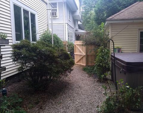 Cedar stockade wooden fence installation