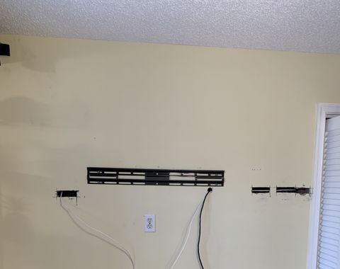 Mounted tv and installed surround sound