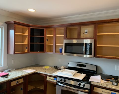 Cabinets changed from cherry  to white cabinet finish