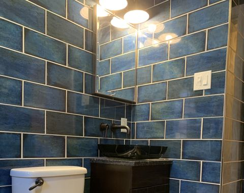 Blue bath, floor to ceiling tile