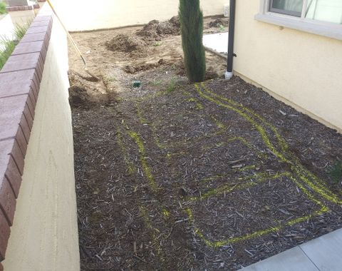The beginning of a concrete stepping stone entryway