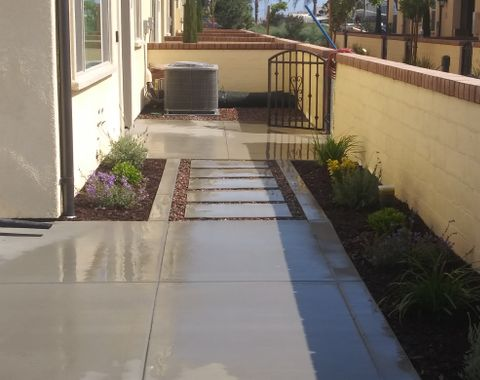 Completion of concrete stepping stone entryway